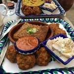 Tasty moussaka, falafels and potato salad