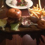 Veal burger with bacon tomato chilli coleslaw onion rings and skinny fries.