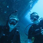 Nicola & Megsi infront of the shipwreck Odyssey