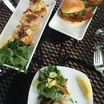 Lobster and shrimp cakes, pecan crusted chicken sliders and shrimp and arugula salad.