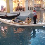 A couple getting married at the Canal shops Gondola ride in the Venetian!