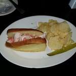 Fresh lobster roll with chips