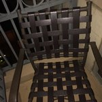 One of the chairs outside on the balcony .. Comes with two chairs and one round table