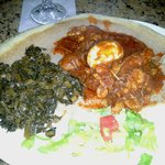 Doro Wat: stewed chicken in red pepper sauce, hard boiled egg and side of collard greens. My fav