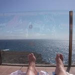 Relaxing by the Infinity pool