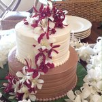 Lilikoi and chocolate cake with orchids