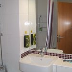 Clean bathroom with soaps/shampoo dispensers