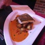 Fish fillet in excellent sauce.