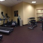 Well equiped gym with TV on each machine and free weights
