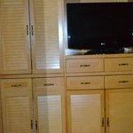 Coffee to left of TV, Refrigerator under TV