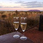 Champagne as the sun sets over Uluru