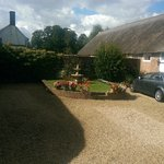 Ample parking next to thatched stables