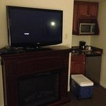 fridge, microwave, sink, and 1 of 2 televisions