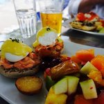 eggs benedict with smoked salmon and a fresh fruit salad (beer too)