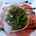 Beef carpaccio with parmesan shavings and rucola