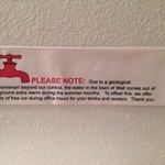 sign in the bathroom at the Sunshine Inn