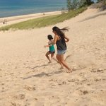 Sister in laws running down the dune