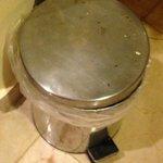 rusty garbage basket