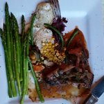 Rack of lamb, scalloped potatoes,  asparagus,  Sunday specialty. Well presented,  prepared as or