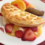 Waffles with vanilla mascarpone filling, lemon curd and fresh strawberries