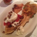 Sunday brunch, smoked salmon, waffle topped with pecan strawberry& crawfish étouffée.