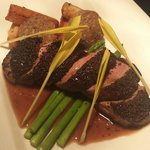Blue poppy seeds crusted barbary duck breast, salsify, white pudding, thai asparagus, popcorn sh