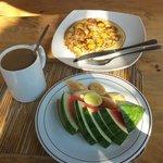 Choice of breakfast: fruit, ginger coffee, thick banana pancake