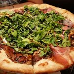 Pizza with greens and balsamic.