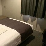 double bed in small room