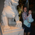 There are two grand Chinese lions at the entrance of the hotel.