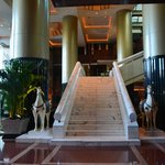 Marble staircase and horses in the lobby entry.