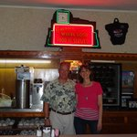 Behind the bar with an original neon sign