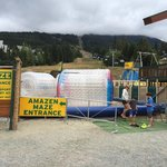Entrance to the maze, water rollers and airbag jump.   All next to the mini golf course