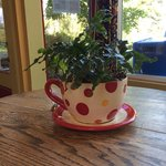 Cute coffee cup planters on the tables!