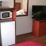 Coffee maker, microwave, fridge, and TV