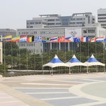 Close up of plaza and flags.