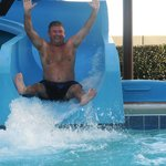 One of the 8 adults having a blast on the slide.