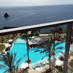view of pool/sea from balcony