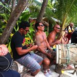 Captain Tam's Crew playing their music on the beach