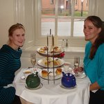 My friend and I with our teapots and selection of goodies.