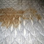 Stained and split top fabric of mattress