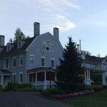 Street view of the Simsbury 1820 House at sunset