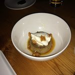 Flan with macadamia nut brittle and whipped cream
