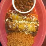 Baja and Beef Enchilada with a side of ranchero beans and rice