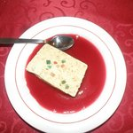 Homemade Nougat Ice Cream with Raspberry Sauce