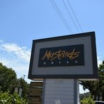 Front Sign of Mustards Grill right on Highway 29.