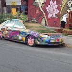 Painted car on street