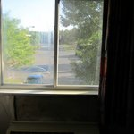 Our room's window with broken glass and some of the missing wallpaper.