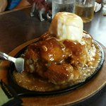 The Best Bread Pudding drowning in caramel sauce.