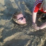 Me being buried into the sand at Swansea beach
